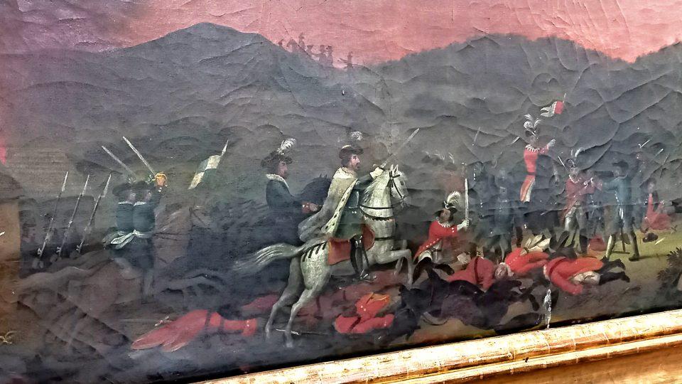 Alegorické zobrazení bitvy ve výseči obrazu v kapli